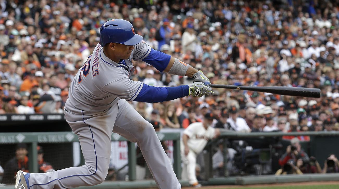 New York Mets' Juan Lagares (12) hits into a fielders choice to score Eric Campbell against the San Francisco Giants during the seventh inning of a baseball game in San Francisco, Wednesday, July 8, 2015. The Mets won 4-1. (AP Photo/Jeff Chiu)