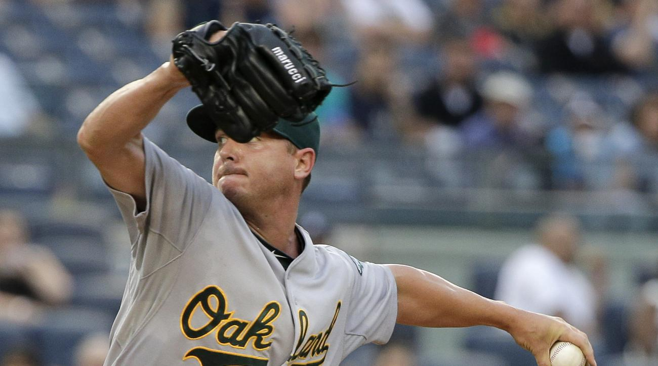 Oakland Athletics pitcher Scott Kazmir delivers against the New York Yankees during the first inning of a baseball game, Wednesday, July 8, 2015, in New York. (AP Photo/Julie Jacobson)