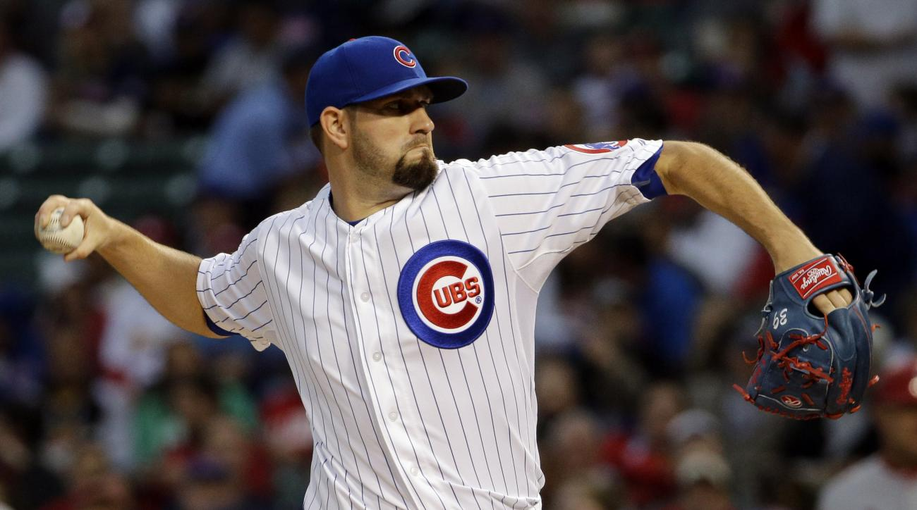 Chicago Cubs starter Jason Hammel throws against the St. Louis Cardinals during the first inning of a baseball game Wednesday, July 8, 2015, in Chicago. (AP Photo/Nam Y. Huh)