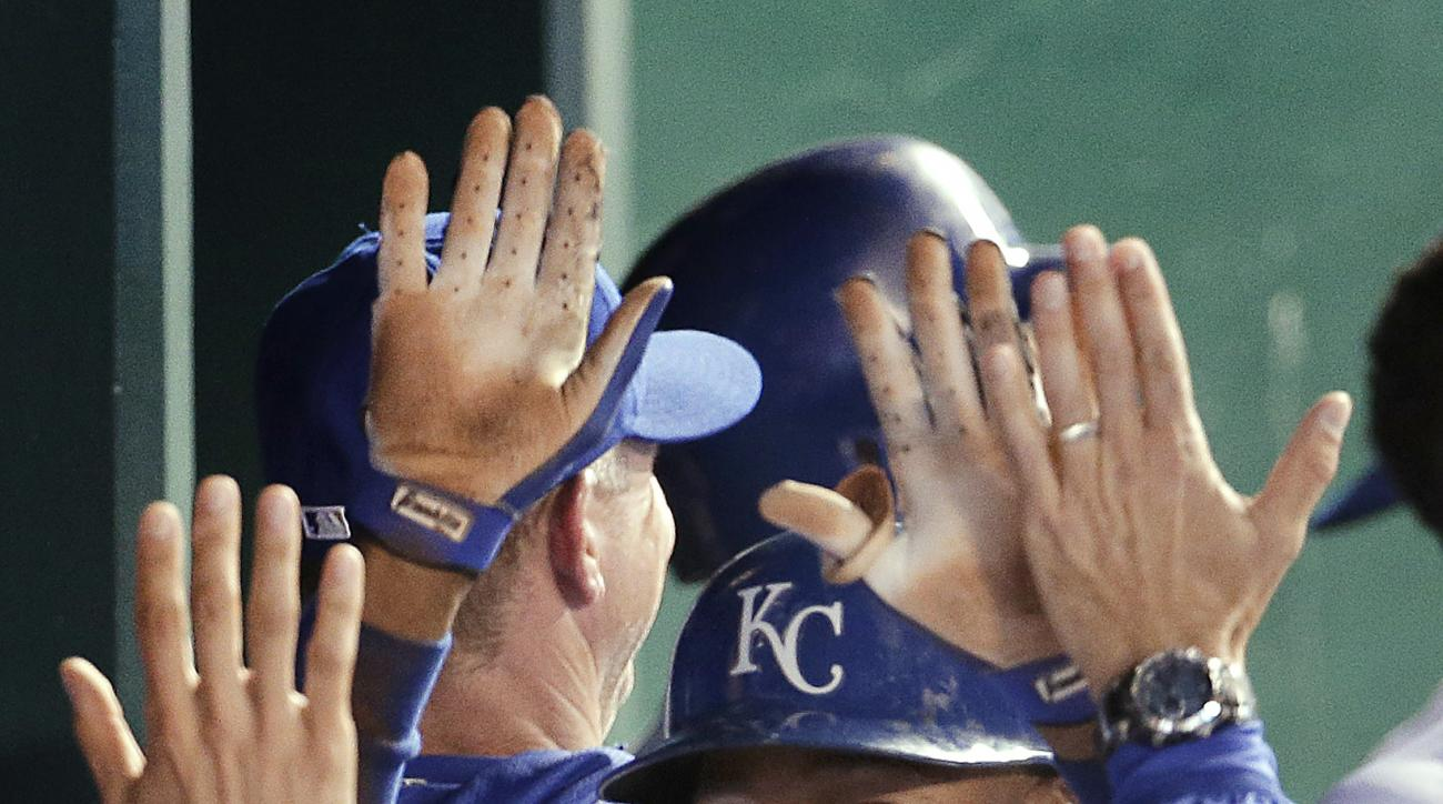 Kansas City Royals' Jarrod Dyson (1) celebrates in the dugout after hitting a two-run inside-the-park home run during the sixth inning of a baseball game against the Tampa Bay Rays on Wednesday, July 8, 2015, in Kansas City, Mo. (AP Photo/Charlie Riedel)