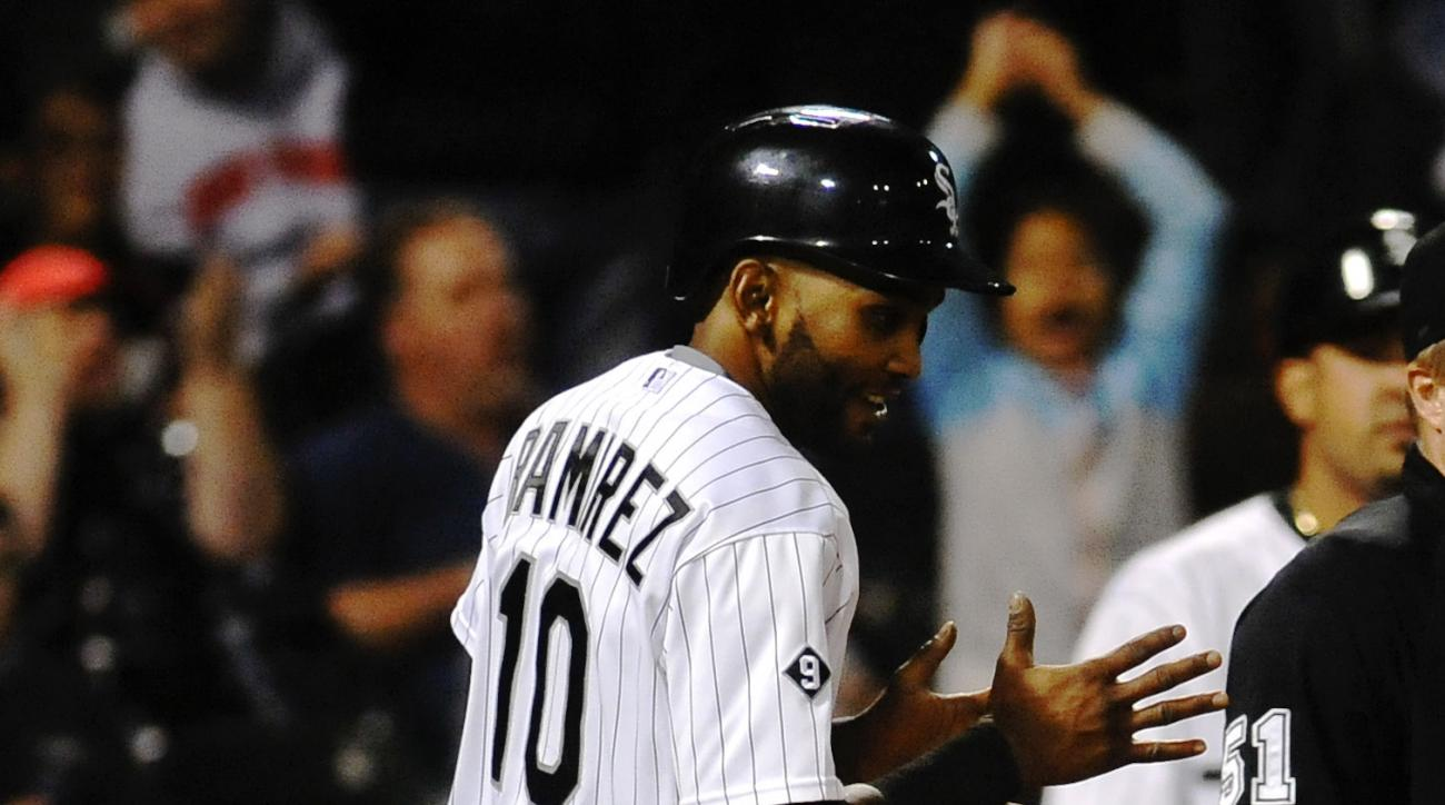 Chicago White Sox's Alexi Ramirez claps after he scored  on an a RBI-single hit by Chicago White Sox's Adam Eaton during the sixth inning of a baseball game against theToronto Blue Jays in Chicago on Wednesday, July 8, 2015. (AP Photo/Matt Marton)