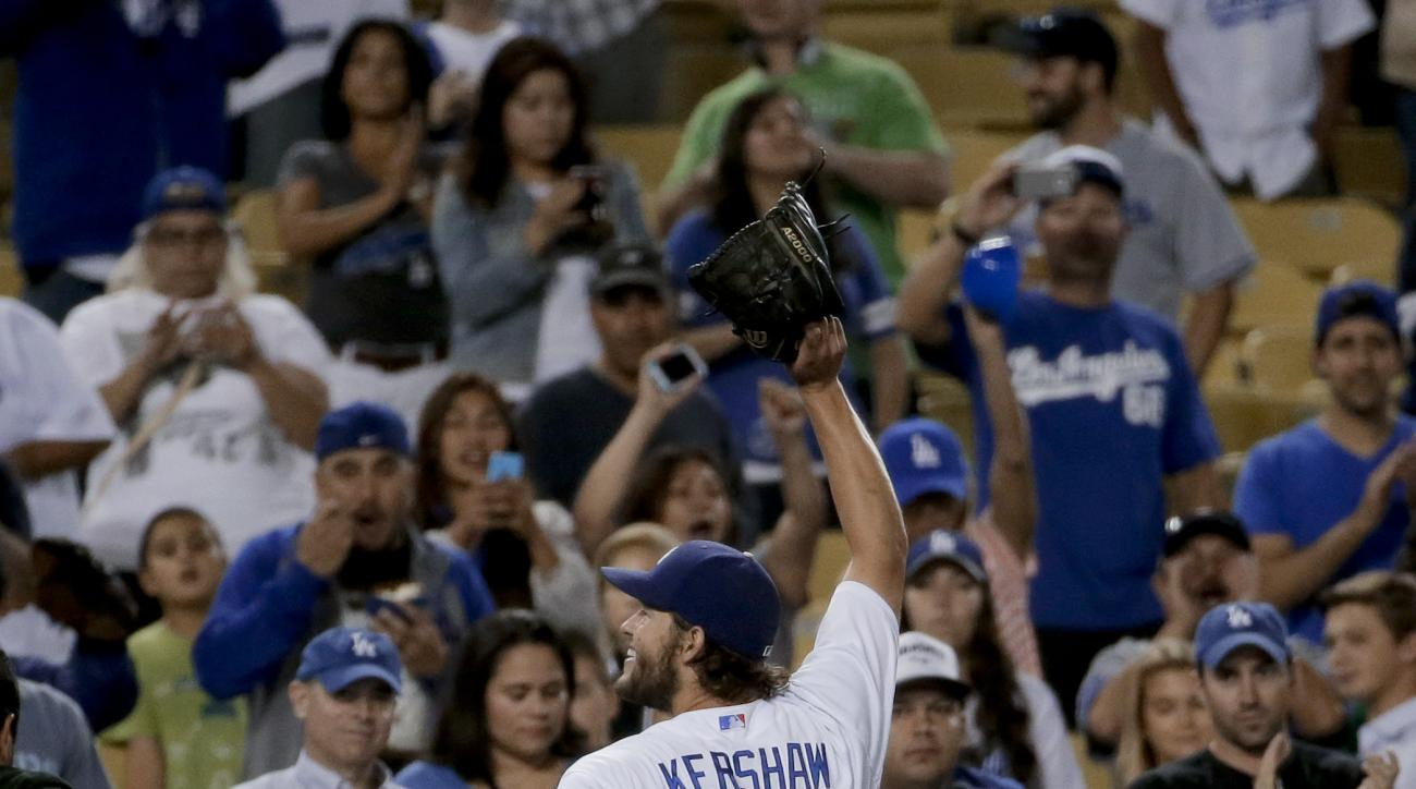 Los Angeles Dodgers starting pitcher Clayton Kershaw waves after pitching a shutout against the Philadelphia Phillies during a baseball game in Los Angeles, Wednesday, July 8, 2015. The Dodgers won 5-0. (AP Photo/Chris Carlson)
