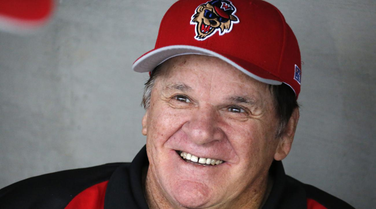 Pete Rose visits with members of the Washington Wild Things in their dugout before a Frontier League baseball game against the Lake Erie Crushers in Washington, Pa, Tuesday, June 30, 2015. Rose coach each baseline for a half inning for the Wild Things aft