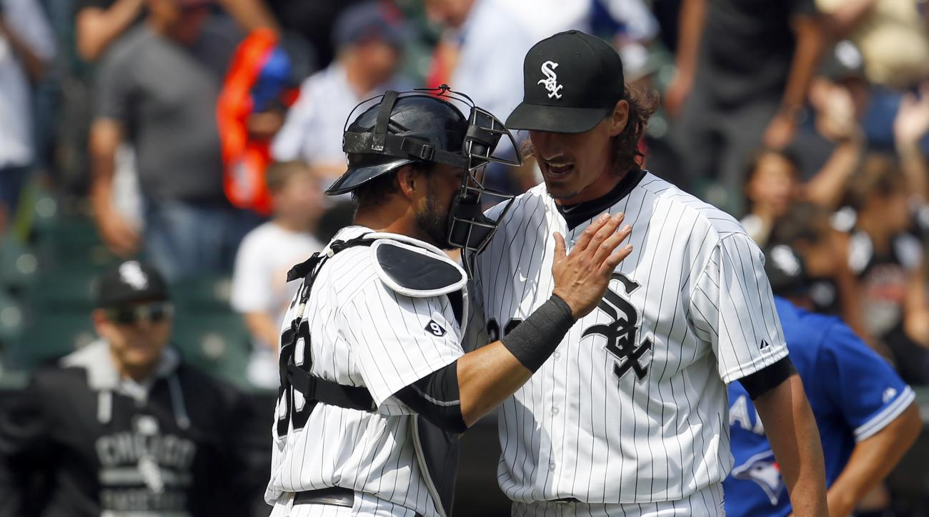 Chicago White Sox catcher Geovany Soto, left, and starting pitcher Jeff Samardzija (29) celebrate after beating the Toronto Blue Jays during a baseball game in Chicago, on Thursday, July 9, 2015. The White Sox won the game 2-0.  (AP Photo/Jeff Haynes)