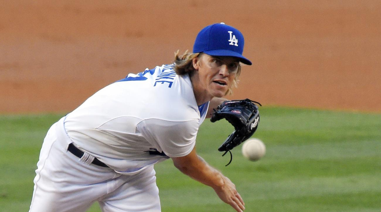 Los Angeles Dodgers starting pitcher Zack Greinke throws to the plate during the second inning of a baseball game against the Philadelphia Phillies, Thursday, July 9, 2015, in Los Angeles. (AP Photo/Mark J. Terrill)