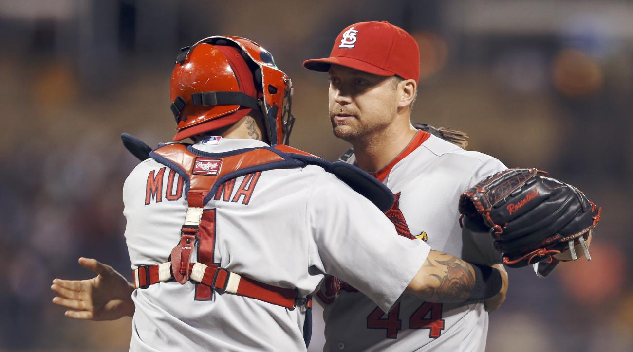 St. Louis Cardinals relief pitcher Trevor Rosenthal celebrates with catcher Yadier Molina after getting the last out of a baseball game against the Pittsburgh Pirates, Thursday, July 9, 2015, in Pittsburgh. The Cardinals won 4-1. (AP Photo/Keith Srakocic)