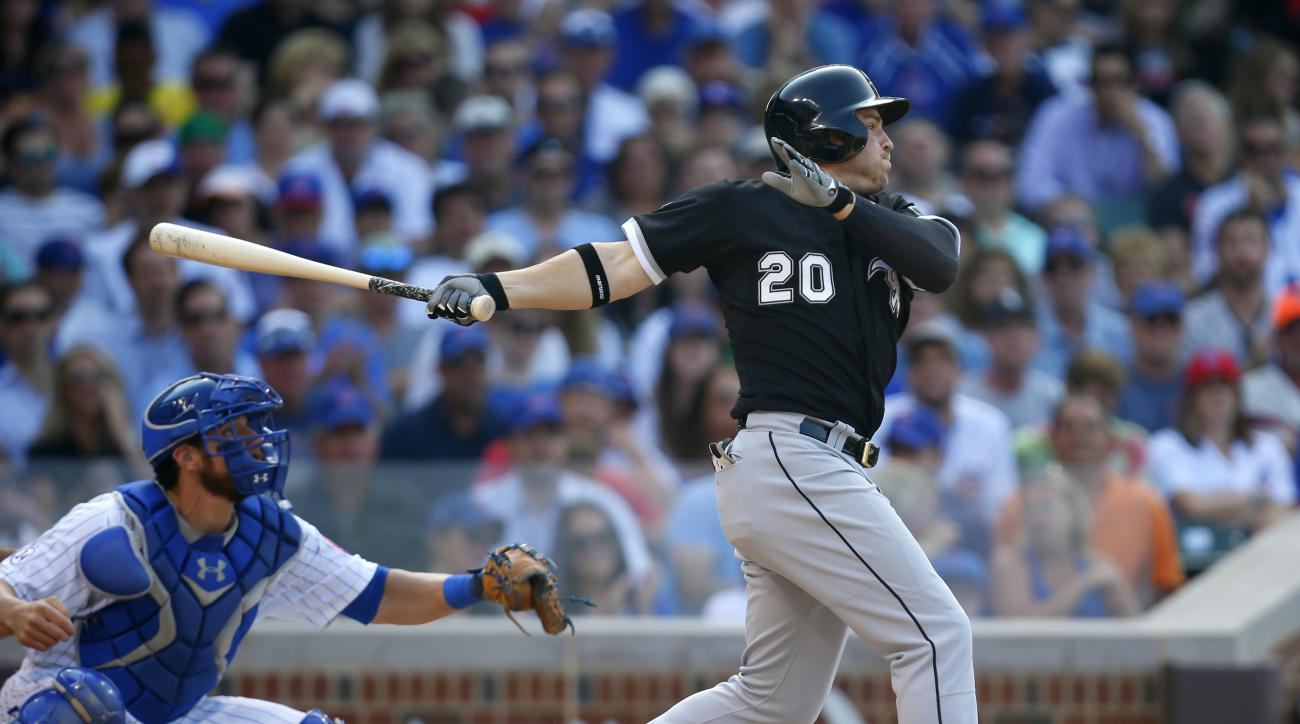 Chicago White Sox right fielder J.B. Shuck (20) and Chicago Cubs catcher Taylor Teagarden (27) watches Shuck's RBI sacrifice during the eighth inning of a baseball game in Chicago, on Friday, July 10, 2015.   (AP Photo/Jeff Haynes)