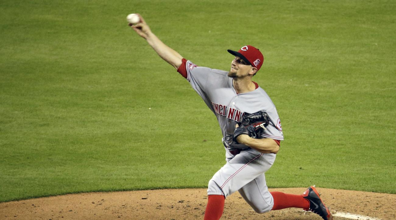 Cincinnati Reds starting pitcher Mike Leake throws in the fourth inning of a baseball game against the Miami Marlins, Friday, July 10, 2015, in Miami. (AP Photo/Lynne Sladky)