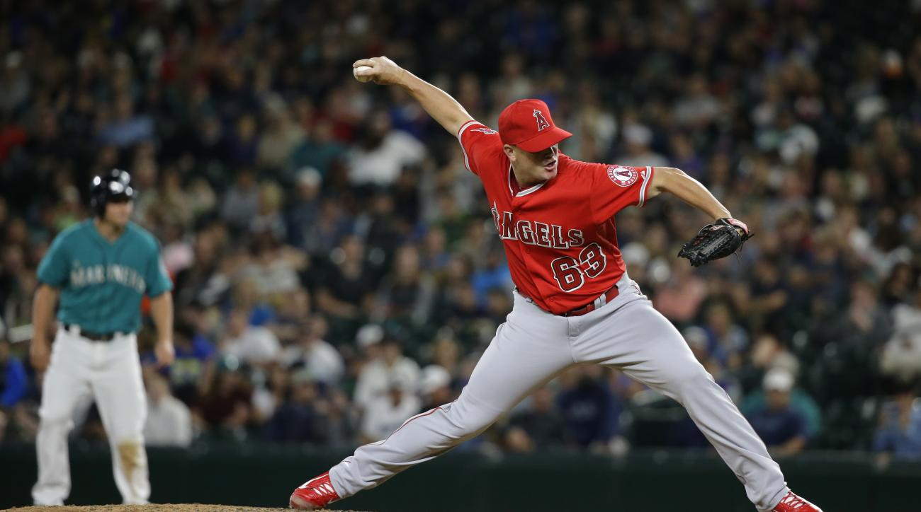 Los Angeles Angels' Vinnie Pestano throws against the Seattle Mariners in the ninth inning of a baseball game, Friday, July 10, 2015, in Seattle. (AP Photo/Ted S. Warren)