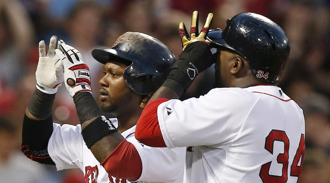 Boston Red Sox's Hanley Ramirez, left, celebrates his two-run home run, that also drove in David Ortiz (34), during the fourth inning of a baseball game against the New York Yankees in Boston, Saturday, July 11, 2015. (AP Photo/Michael Dwyer)
