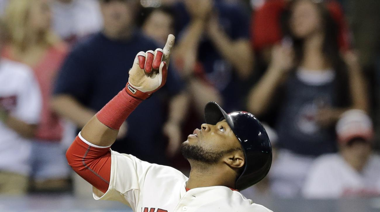 Cleveland Indians' Carlos Santana points up after hitting a two-run home run off Oakland Athletics relief pitcher Edward Mujica duirng the eighth inning of a baseball game, Saturday, July 11, 2015, in Cleveland. (AP Photo/Tony Dejak)