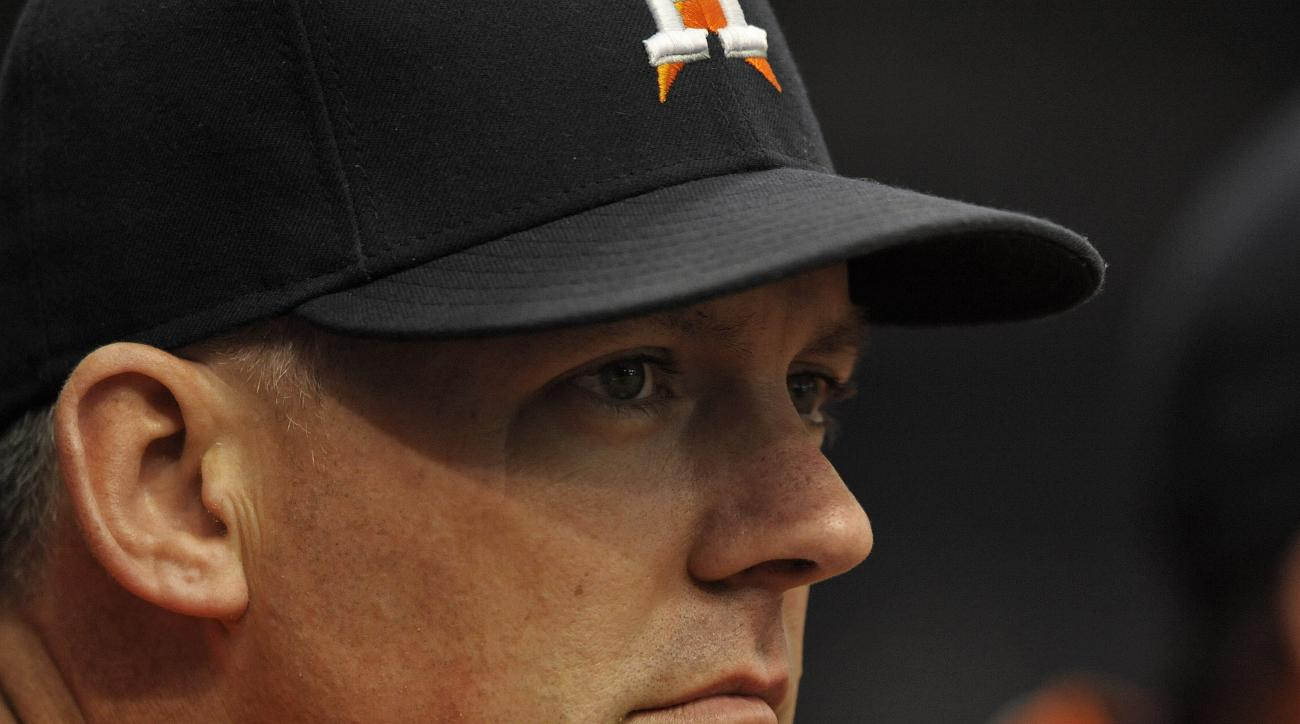 Houston Astros manager A.J. Hinch watches his team play the Tampa Bay Rays during the first inning of a baseball game Sunday, July 12, 2015, in St. Petersburg, Fla. (AP Photo/Steve Nesius)