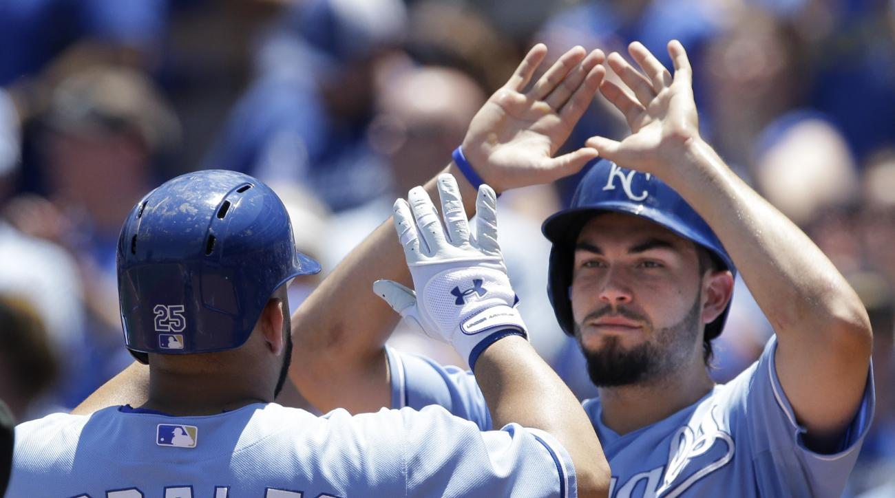 Kansas City Royals designated hitter Kendrys Morales (25) is congratulated by teammate Eric Hosmer (35) after his three-run home run off Toronto Blue Jays starting pitcher Felix Doubront during the first inning of a baseball game at Kauffman Stadium in Ka