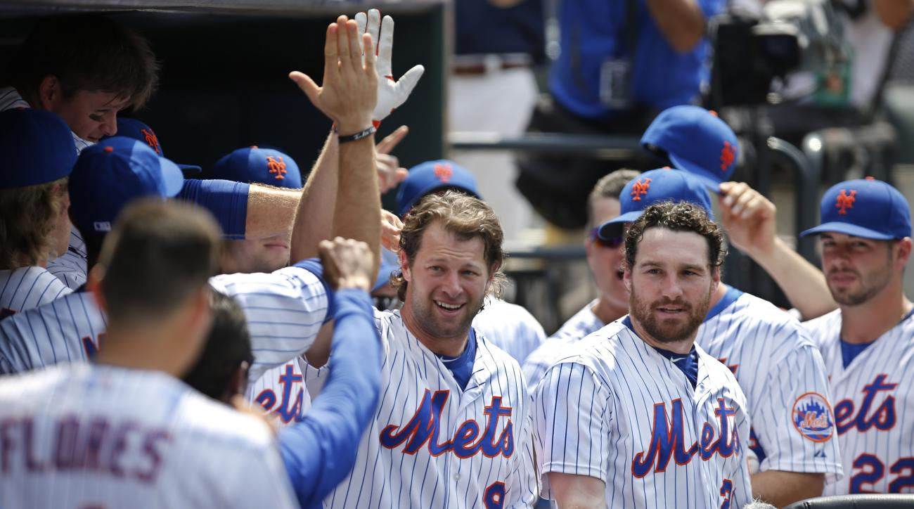 Teammates congratulate New York Mets  Kirk Nieuwenhuis (9) after his fifth-inning solo home run, his third home run of the day, in a baseball game against the Arizona Diamondbacks in New York, Sunday, July 12, 2015. The first two home runs came off starti