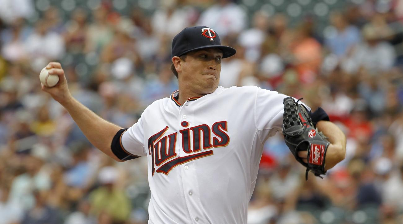 Minnesota Twins starting pitcher Kyle Gibson delivers to the Detroit Tigers during the first inning of a baseball game in Minneapolis, Sunday, July 12, 2015. (AP Photo/Ann Heisenfelt)