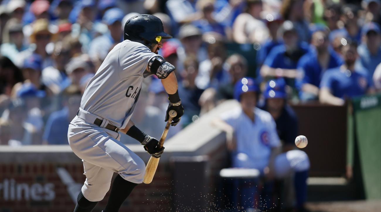 Chicago White Sox's Adam Eaton hits a sacrifice bunt for an RBI against the Chicago Cubs during the sixth inning of a baseball game Sunday, July 12, 2015, in Chicago. (AP Photo/Andrew A. Nelles)