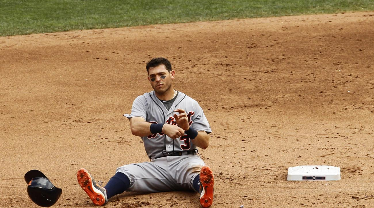 Detroit Tigers' Ian Kinsler (3) tosses his batting helmet after being forced out at second base by Minnesota Twins shortstop Danny Santana during the sixth inning of a baseball game in Minneapolis, Sunday, July 12, 2015. The Twins won 7-1. (AP Photo/Ann H