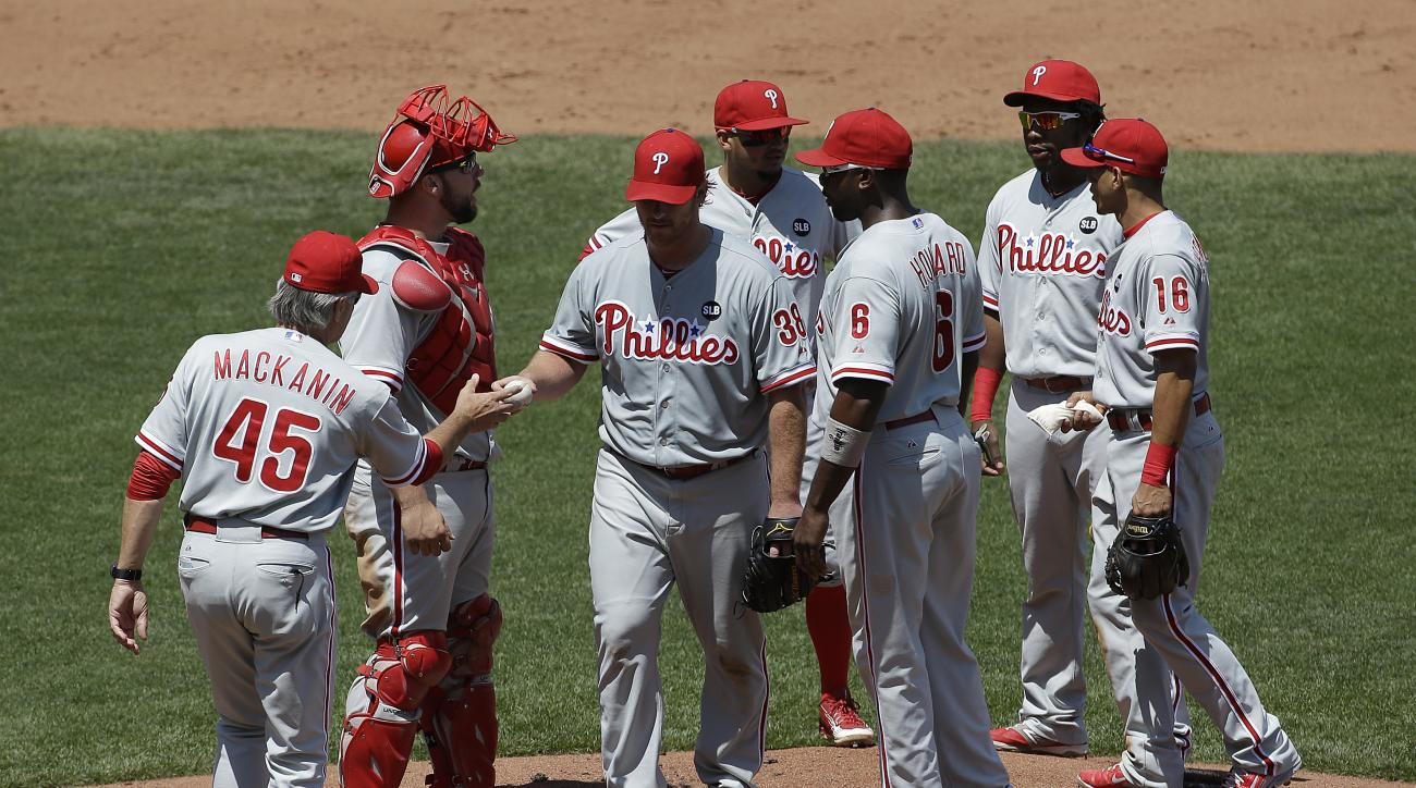 Philadelphia Phillies interim manager Pete Mackanin (45) takes the ball from starting pitcher Chad Billingsley (38) during the sixth inning of a baseball game against the San Francisco Giants in San Francisco, Sunday, July 12, 2015. (AP Photo/Jeff Chiu)