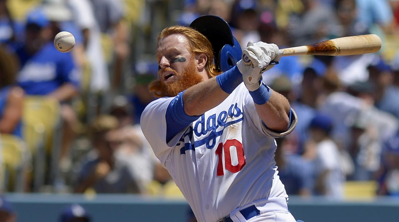 Los Angeles Dodgers' Justin Turner has his helmet knocked off by a foul ball as he bats in the during the fourth inning of a baseball game against the Milwaukee Brewers, Sunday, July 12, 2015, in Los Angeles. (AP Photo/Mark J. Terrill)