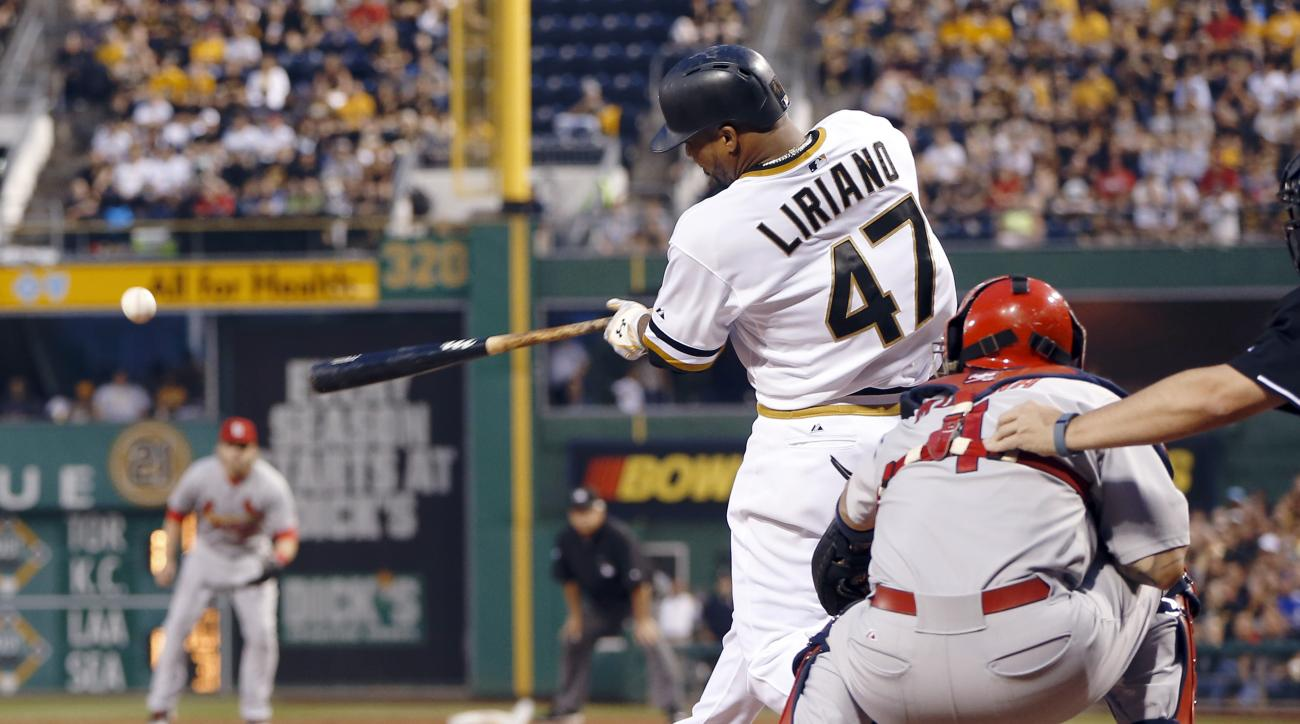 Pittsburgh Pirates starting pitcher Francisco Liriano (47) drives in two runs with a hit in front of St. Louis Cardinals catcher Yadier Molina (4) in the second inning of a baseball game, Sunday, July 12, 2015, in Pittsburgh. (AP Photo/Keith Srakocic)