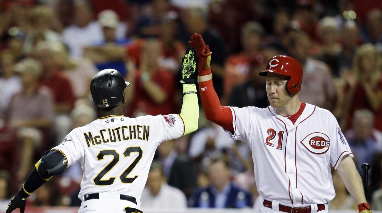 National League's Andrew McCutchen, of the Pittsburgh Pirates, is congratulated by National League's Todd Frazier, of the Cincinnati Reds, after hitting a home run during the sixth inning of the MLB All-Star baseball game, Tuesday, July 14, 2015, in Cinci