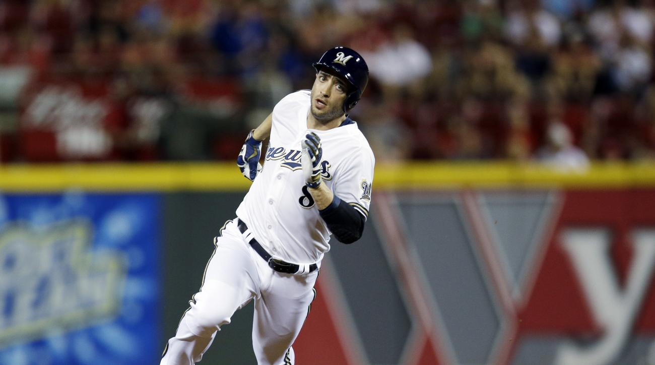 National League's Ryan Braun, of the Milwaukee Brewers, hits a triple during the ninth inning of the MLB All-Star baseball game, Tuesday, July 14, 2015, in Cincinnati. (AP Photo/John Minchillo)