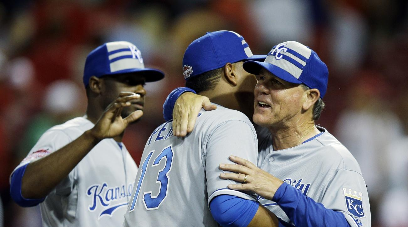 American League manager Ned Yost, of the Kansas City Royals hugs American League's Salvador Perez, of the Kansas City Royals after the MLB All-Star baseball game, Tuesday, July 14, 2015, in Cincinnati. The American League won 6-3. (AP Photo/John Minchillo
