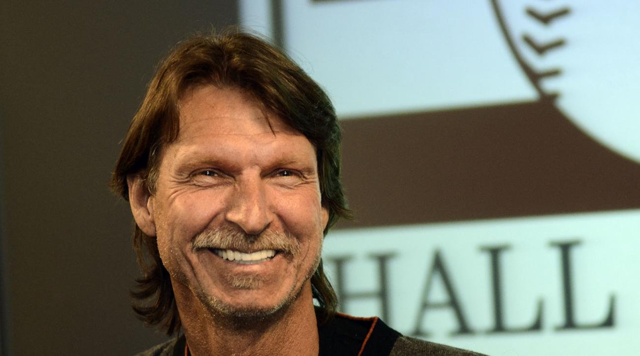 FILE - In this March 28, 2015, file photo, Hall of Fame pitcher Randy Johnson smiles during a press conference following his tour through the National Baseball Hall of Fame in Cooperstown, N.Y. Organizers have canceled plans to temporarily put newly elect
