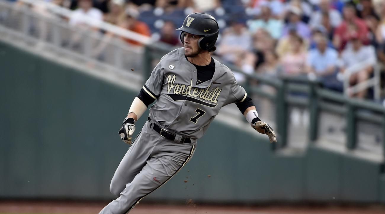 FILE - In this June 23, 2015, file photo, Vanderbilt's Dansby Swanson rounds second base on his way to third on a teammate's single against Virginia during Game 2 of the best-of-three NCAA baseball College World Series finals in Omaha, Neb. Just three of