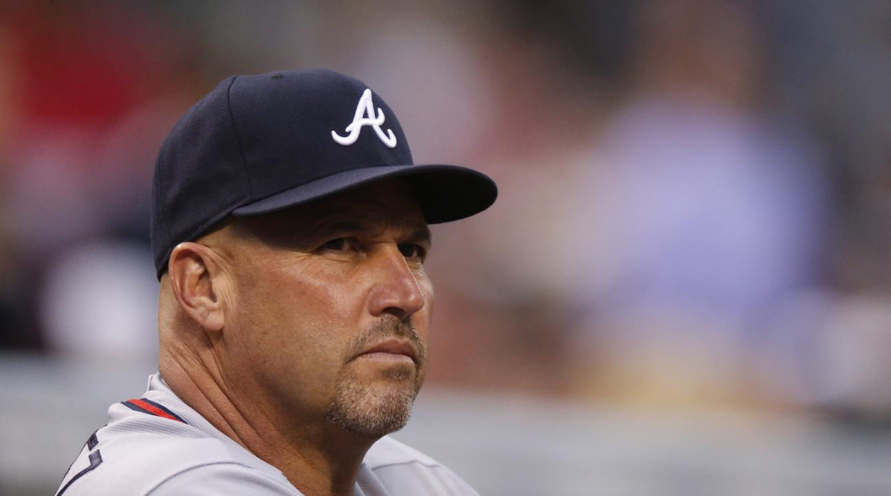 Atlanta Braves manager Fredi Gonzalez (33) looks on against the Colorado Rockies in the first inning of a baseball game Thursday, July 9, 2015, in Denver. (AP Photo/David Zalubowski)