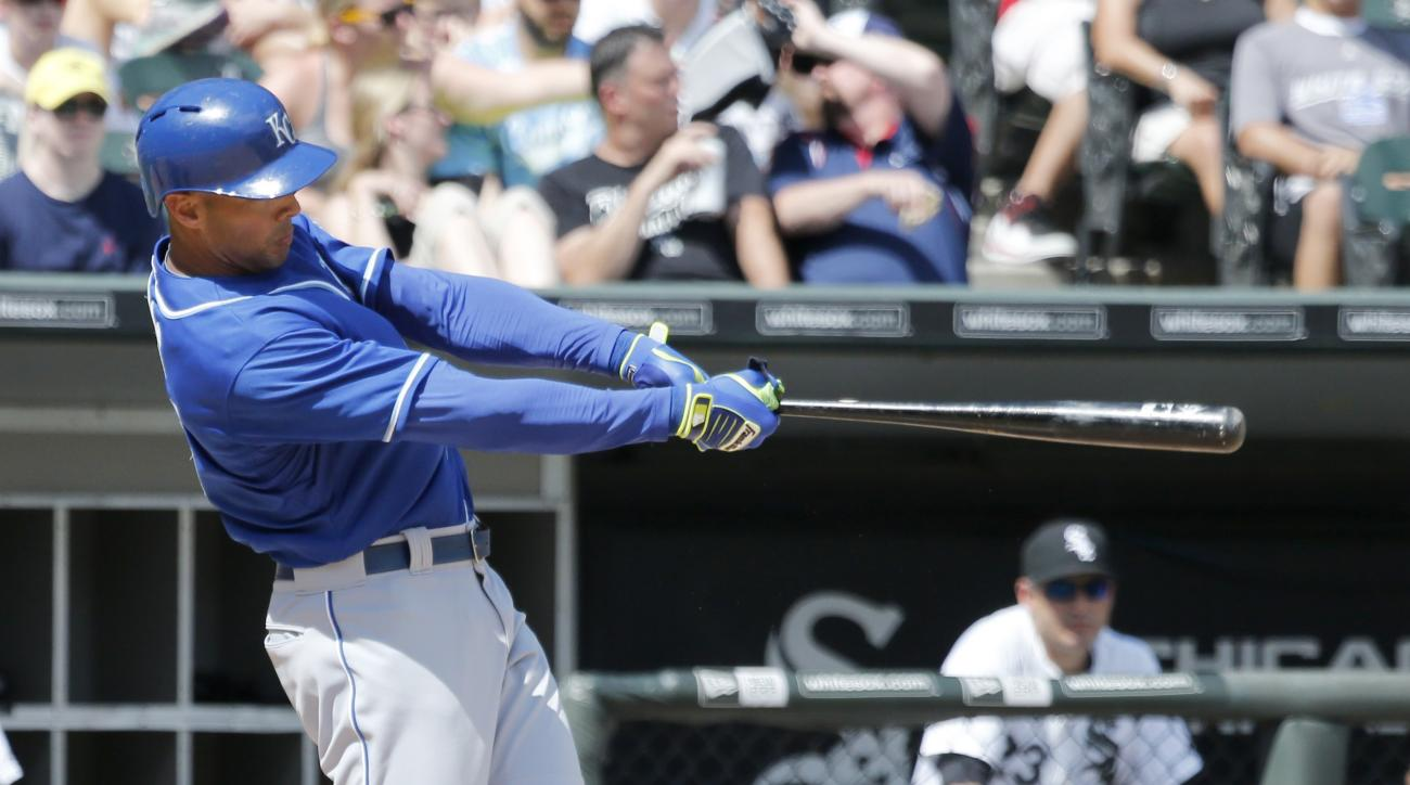 Alex Rios hits a home run off Chicago White Sox starting pitcher Jeff Samardzija during the sixth inning of a baseball game Friday, July 17, 2015, in Chicago. (AP Photo/Charles Rex Arbogast)