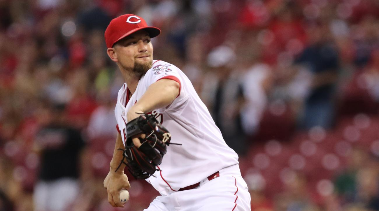 Cincinnati Reds starting pitcher Mike Leake throws against the Cleveland Indians during the first inning of a baseball game, Friday, July 17, 2015, in Cincinnati. (AP Photo/Gary Landers)