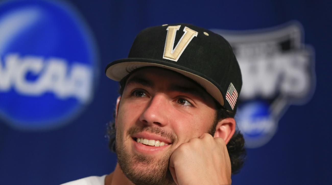 FILE - In this June 21, 2015, file photo, Vanderbilt shortstop Dansby Swanson smiles during a news conference in Omaha, Neb., Sunday, June 21, 2015, ahead of the best-of-three NCAA College World Series baseball championship finals against Virginia. Swanso
