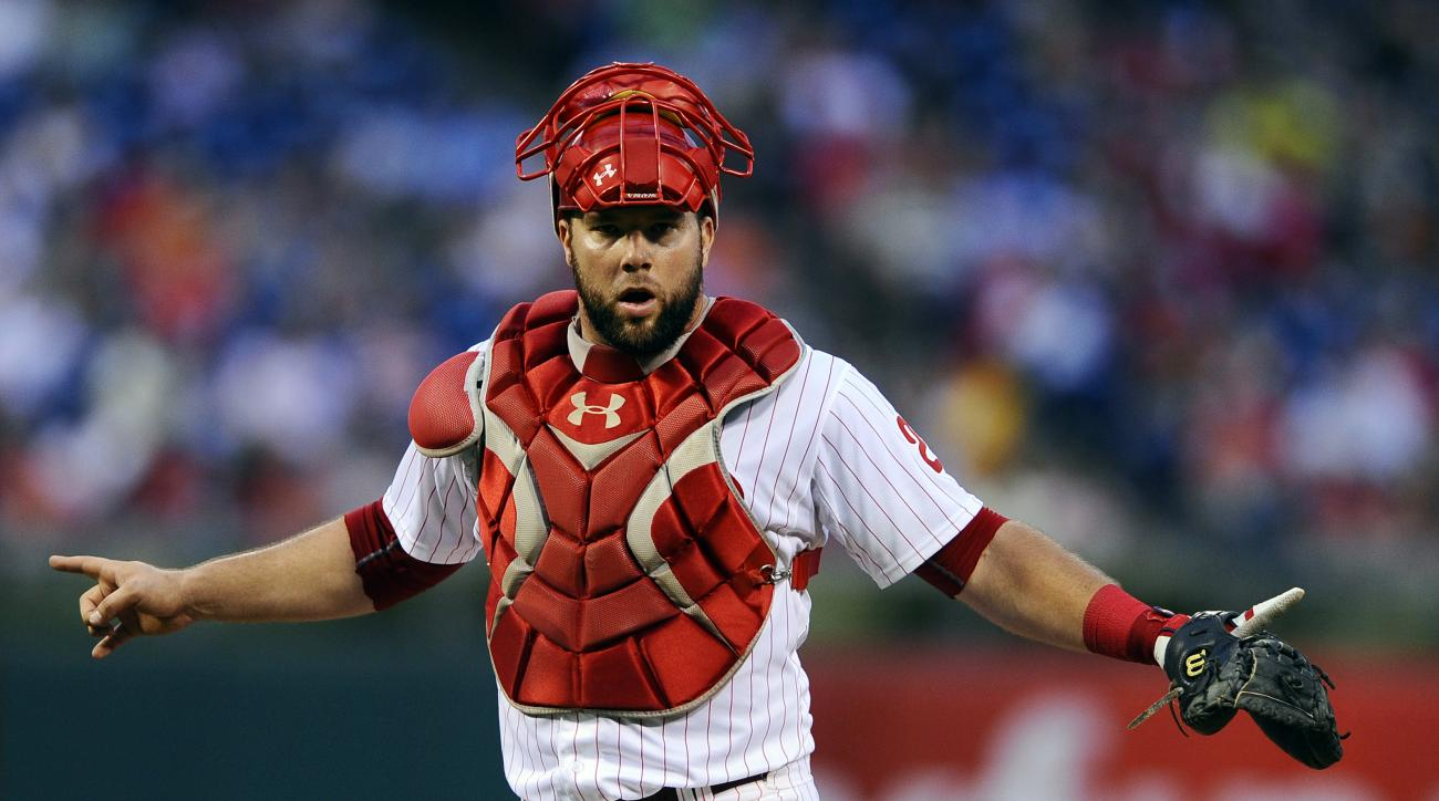 Philadelphia Phillies catcher Cameron Rupp signals to the dugout in the fourth inning of a baseball game against Miami Marlins, Friday, July 17, 2015, in Philadelphia. (AP Photo/Michael Perez)