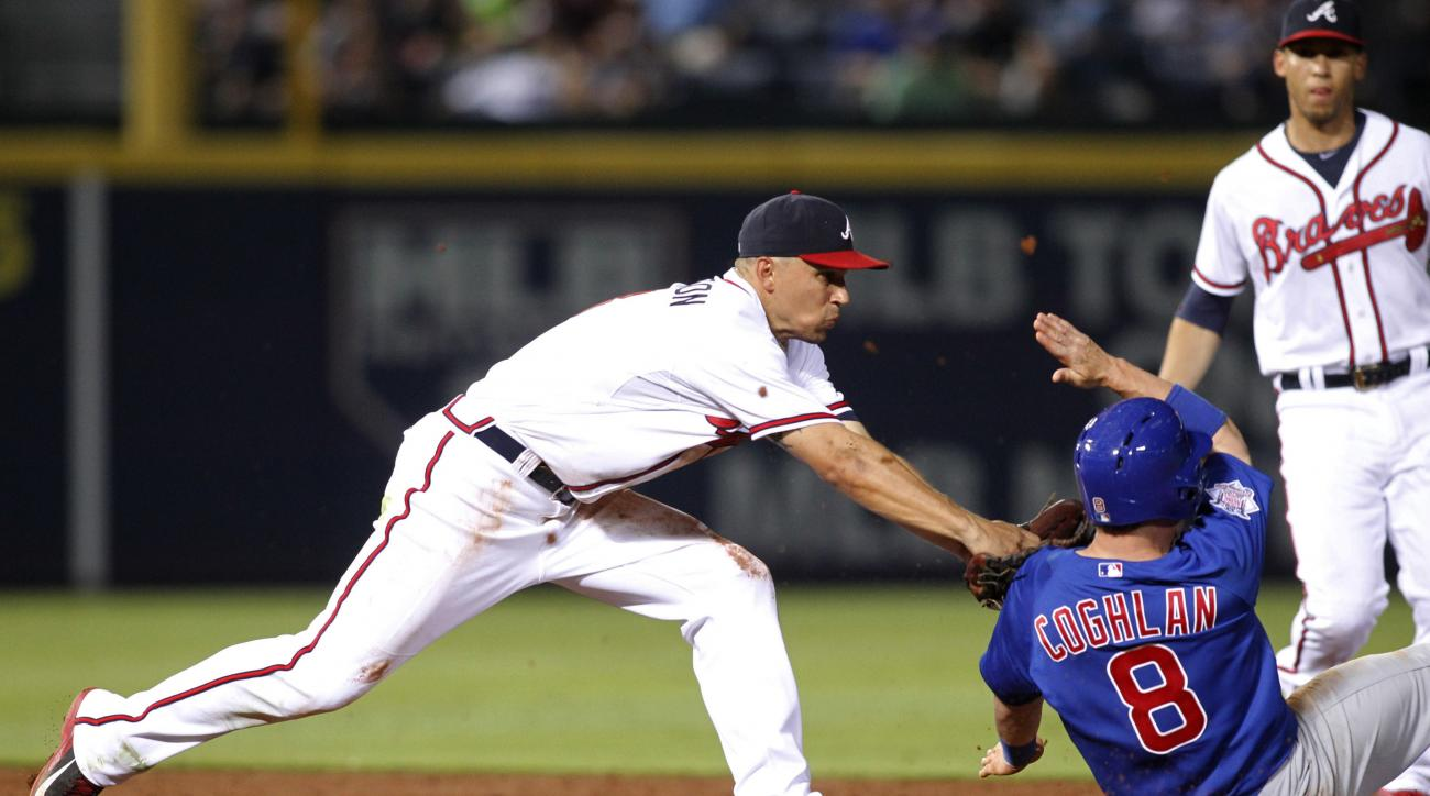 Atlanta Braves second baseman Jace Peterson tags Chicago Cubs' Chris Coghlan (8) before throwing to first for a double play during the sixth inning of a baseball game, Friday, July 17, 2015, in Atlanta. Starlin Castro was out at first. (AP Photo/Brett Dav