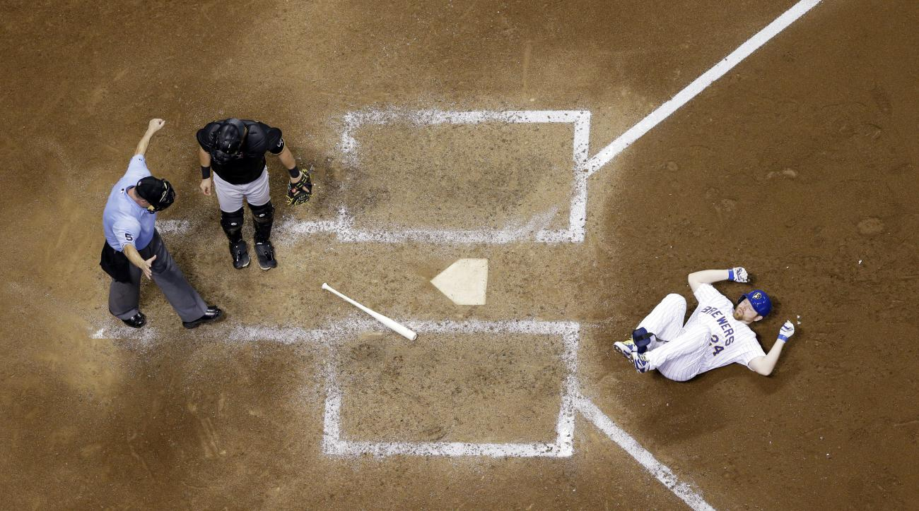 Milwaukee Brewers' Adam Lind reacts after being hit by a pitch during the seventh inning of a baseball game against the Pittsburgh Pirates Friday, July 17, 2015, in Milwaukee. (AP Photo/Morry Gash)