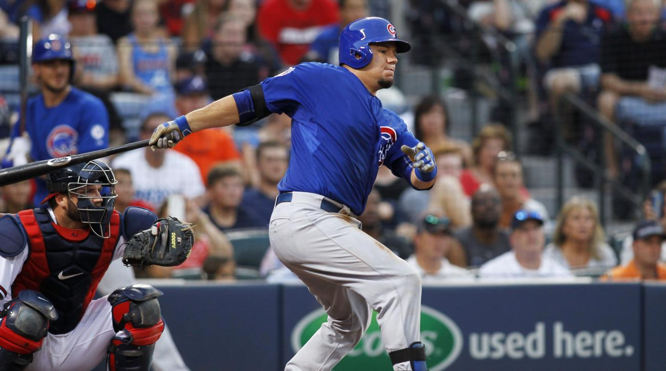 Chicago Cubs' Kyle Schwarber hits a single in front of Atlanta Braves catcher A.J. Pierzynski during the third inning of a baseball game Friday, July 17, 2015, in Atlanta. (AP Photo/Brett Davis)