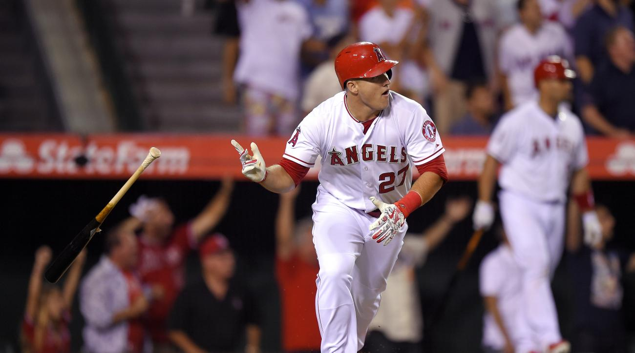 Los Angeles Angels' Mike Trout tosses his bat after hitting a solo home run during the ninth inning of a baseball game against the Boston Red Sox, Friday, July 17, 2015, in Anaheim, Calif. The Angels won 1-0. (AP Photo/Mark J. Terrill)