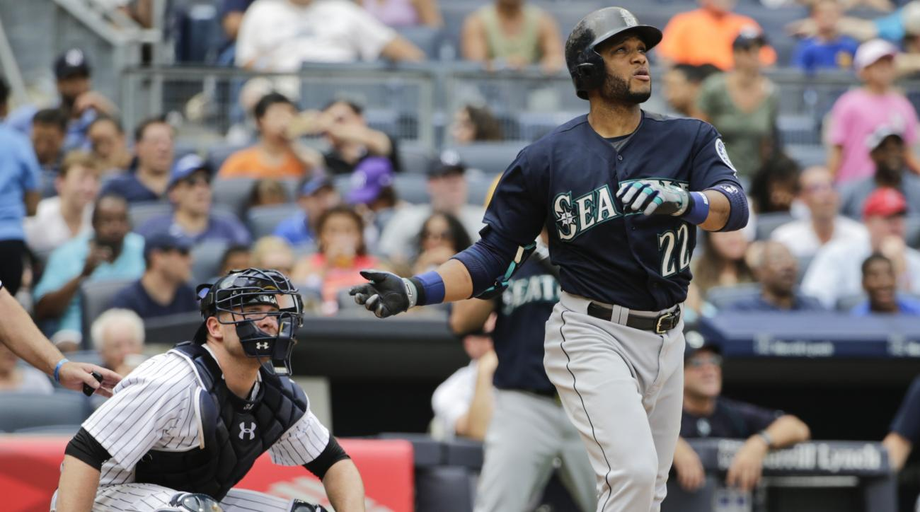 Seattle Mariners' Robinson Cano (22), right, and New York Yankees catcher Brian McCann watch a ball hit by Cano for a two run home run during the sixth inning of a baseball game Saturday, July 18, 2015, in New York. (AP Photo/Frank Franklin II)