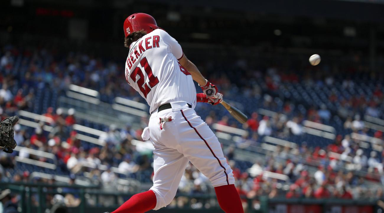 Washington Nationals' Matt den Dekker hits a two-run game winning homer during the eighth inning of a resumed baseball game against the Los Angeles Dodgers at Nationals Park, Saturday, July 18, 2015, in Washington. The game was resumed in the top of the s