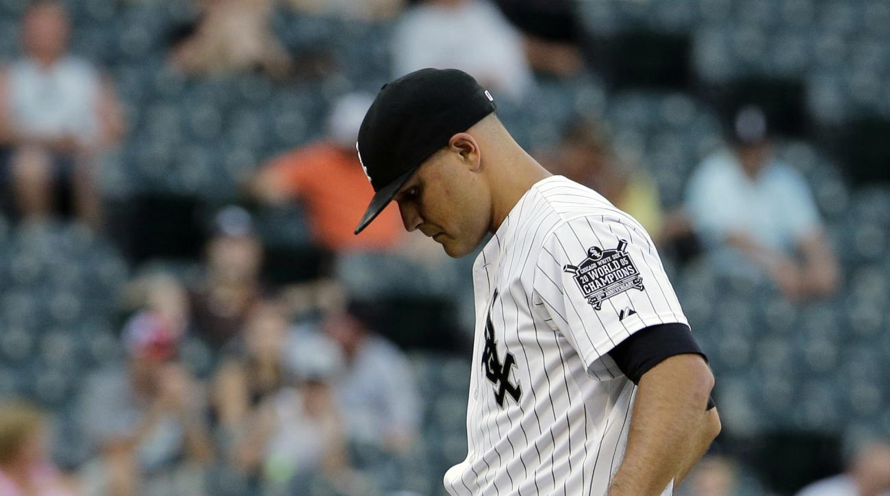 Chicago White Sox relief pitcher Dan Jennings kicks the mound after Kansas City Royals' Lorenzo Cain hit a solo home run during the 13th inning of a baseball game Saturday, July 18, 2015, in Chicago. The Royals won 7-6. (AP Photo/Nam Y. Huh)
