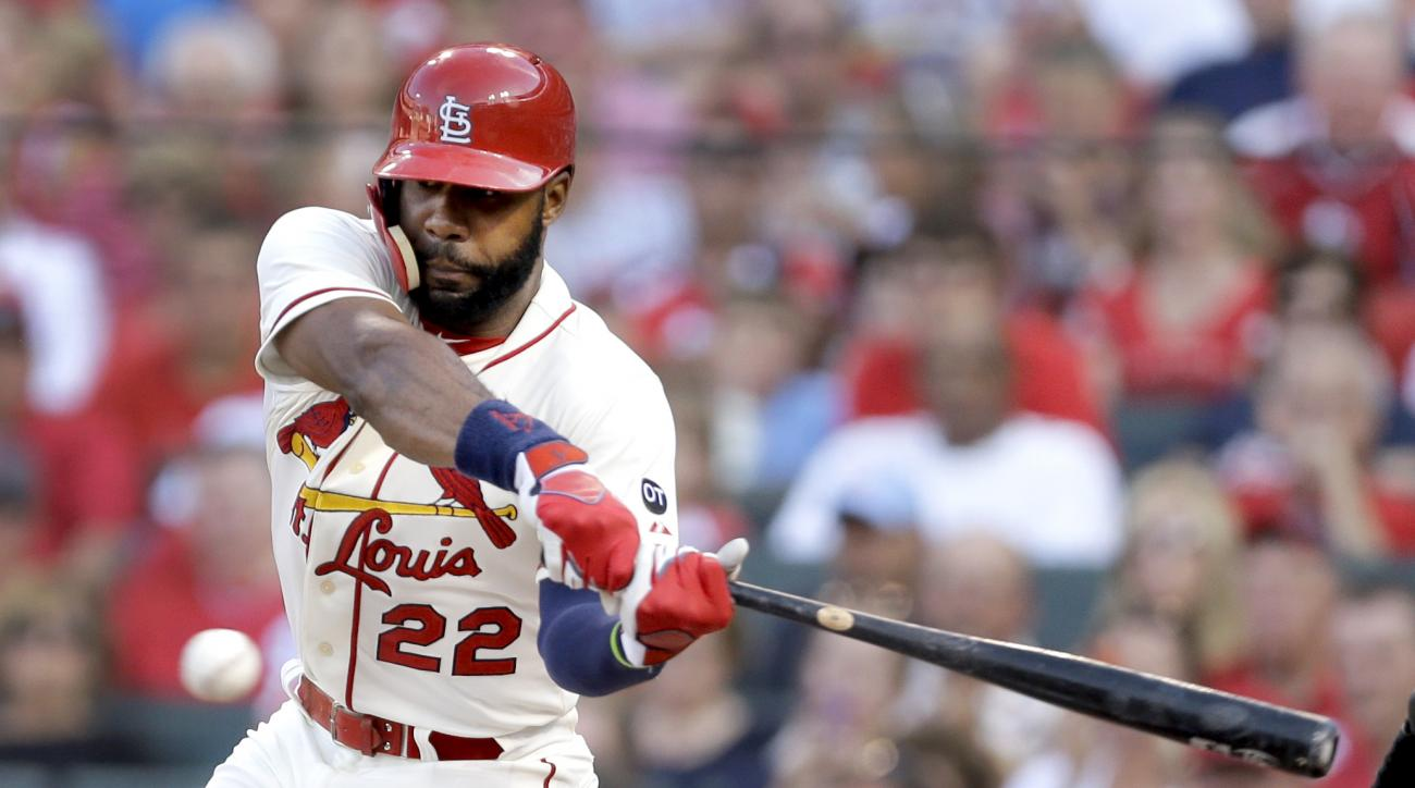 St. Louis Cardinals' Jason Heyward hits an RBI-single during the first inning of a baseball game against the New York Mets, Saturday, July 18, 2015, in St. Louis. (AP Photo/Jeff Roberson)