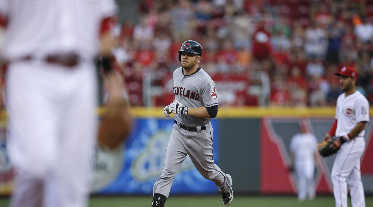 Cleveland Indians' Brandon Moss rounds the bases after hitting a two-run home run off Cincinnati Reds starting pitcher Anthony DeSclafani during the third inning of a baseball game, Saturday, July 18, 2015, in Cincinnati. (AP Photo/John Minchillo)