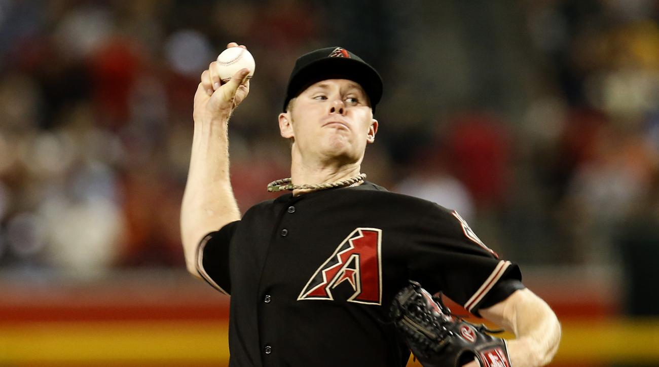 Arizona Diamondbacks pitcher Chase Anderson throws in the first inning during a baseball game against the San Francisco Giants, Saturday, July 18, 2015, in Phoenix. (AP Photo/Rick Scuteri)