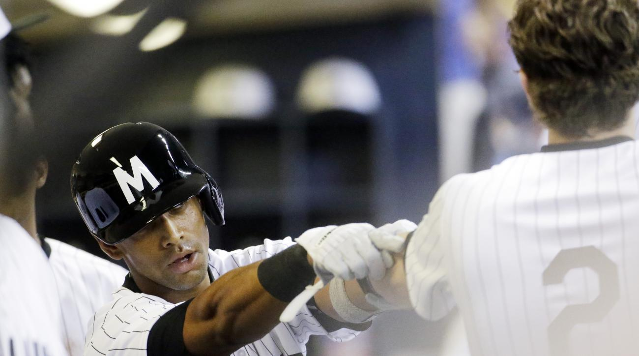 Milwaukee Brewers' Khris Davis celebrates his home run with teammates during the seventh inning of a baseball game against the Pittsburgh Pirates Saturday, July 18, 2015, in Milwaukee. (AP Photo/Morry Gash)