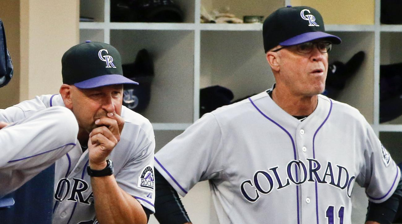 Colorado Rockies manager Walt Weiss, left, and coach Tom Runnells look on as then San Diego Padres score twice in the sixth inning of a baseball game Saturday, July 18, 2015, in San Diego.   (AP Photo/Lenny Ignelzi)