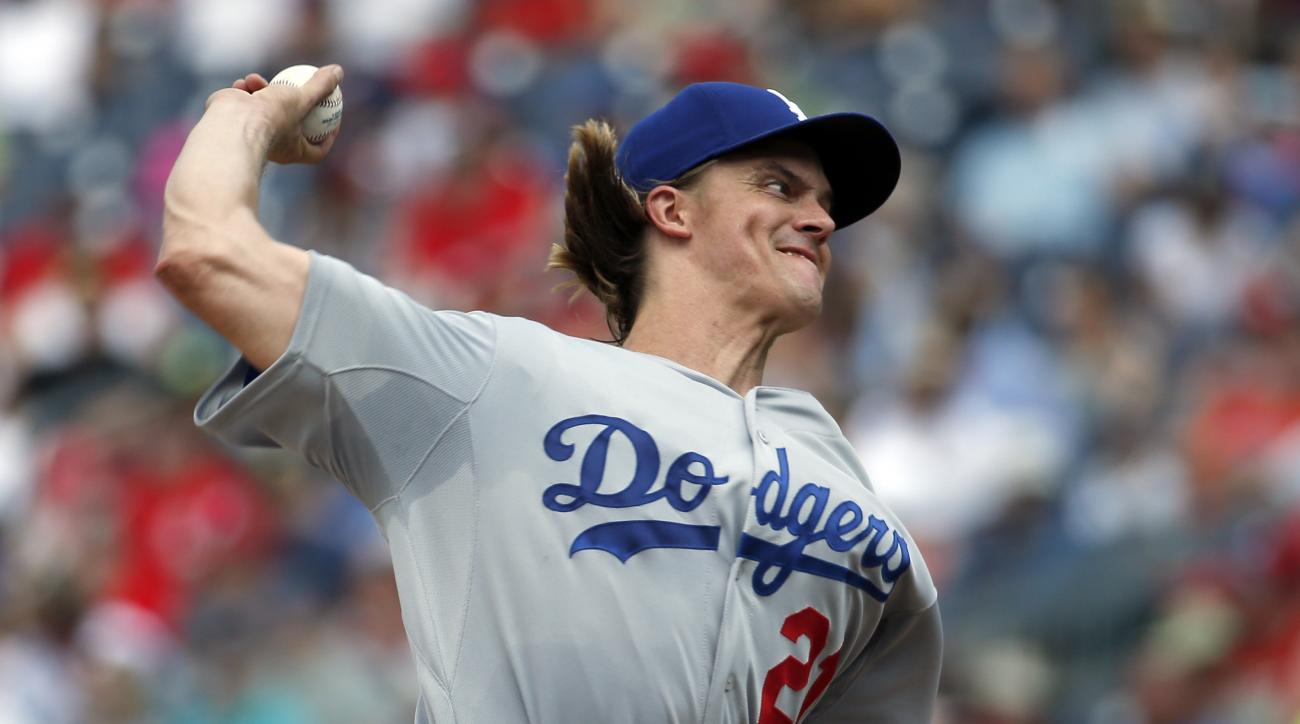 Los Angeles Dodgers starting pitcher Zack Greinke throws during the third inning of a baseball game against the Washington Nationals at Nationals Park, Sunday, July 19, 2015, in Washington. (AP Photo/Alex Brandon)