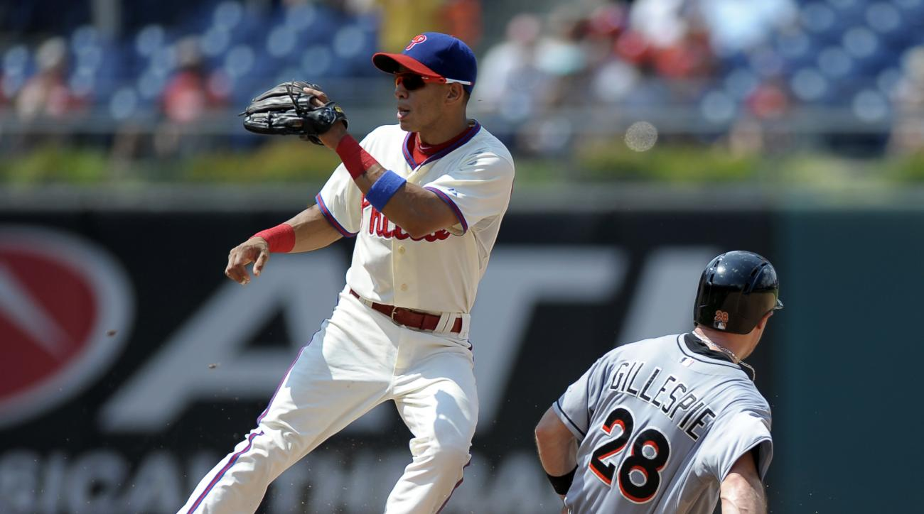 Miami Marlins' Cole Gillespie (28) steals second base ahead of Philadelphia Phillies' Cesar Hernandez in the third inning of a baseball game Sunday, July 19, 2015, in Philadelphia. (AP Photo/Michael Perez)