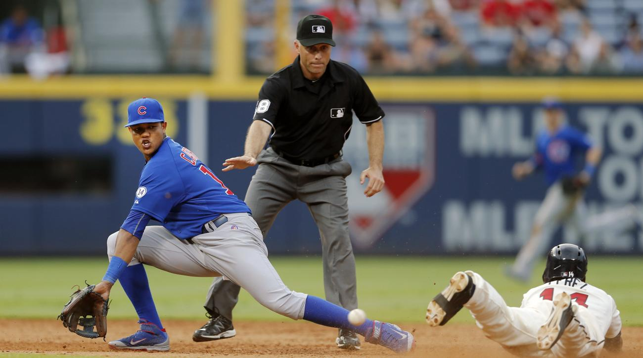Atlanta Braves' Eury Perez (14) is safe at second base with a double as Chicago Cubs shortstop Starlin Castro (13) handles the throw in the seventh inning of a baseball game Sunday, July 19, 2015, in Atlanta. (AP Photo/John Bazemore)