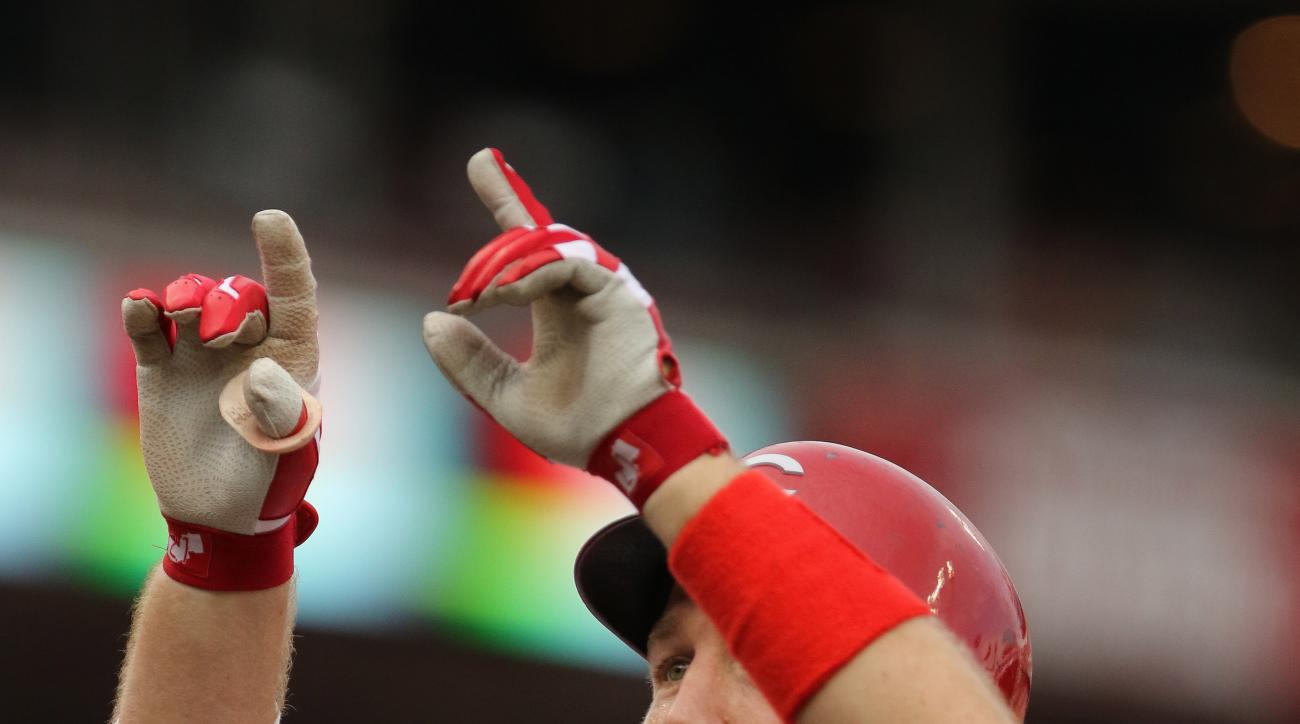 Cincinnati Reds third baseman Todd Frazier points skyward after hitting a solo home run off Chicago Cubs starting pitcher Clayton Richard during the first inning of a baseball game, Monday, July 20, 2015, in Cincinnati. (AP Photo/Gary Landers)